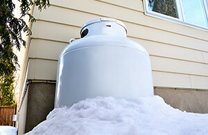 propane tank covered in snow